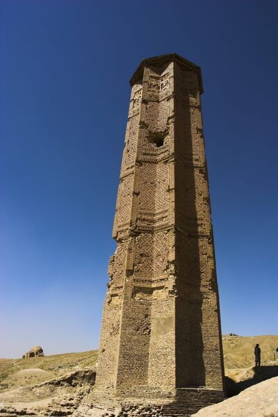 Man looking at Minaret of Bahram Shah one of two early 12th century minarets, Ghazni, Afghanistan, Asia