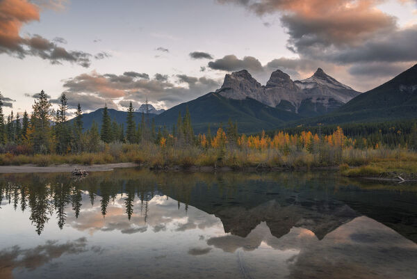 Sunset over Three Sisters in Autumn near Banff National Park, UNESCO World Heritage Site