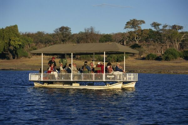 Tourists game viewing on boat on the Chobe River, Chobe National Park, Botswana, Africa