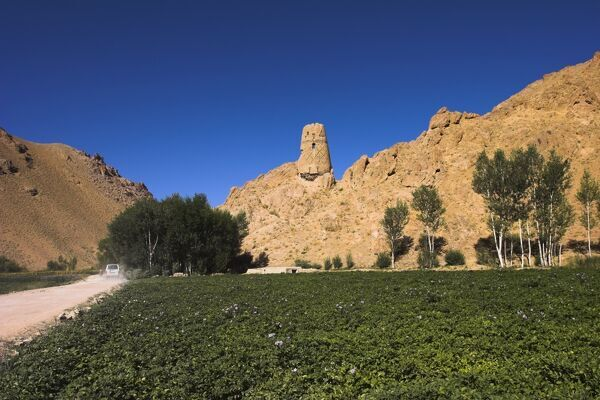 Watchtower at ruins which were once the site of a tall standing Buddha in a niche, Kakrak valley, Bamiyan, Afghanistan, Asia