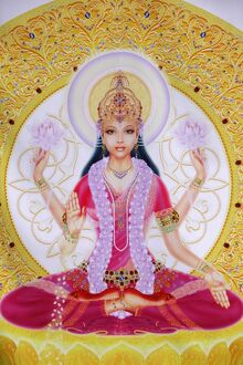 Picture of Lakshmi, goddess of wealth and consort of Lord Vishnu, sitting holding