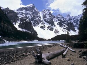 Reduced water level in Moraine Lake following a dry year, and Wenkchemna Mountains