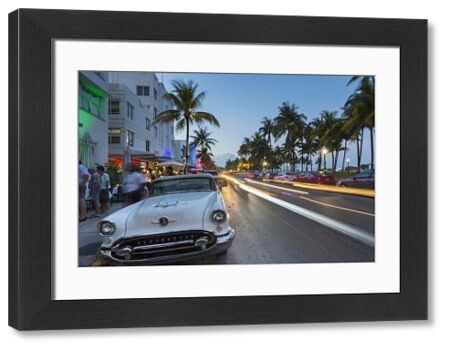 Ocean Drive restaurants, vintage car and Art Deco architecture at dusk, South Beach, Miami Beach, Miami, Florida, United States of America, North America