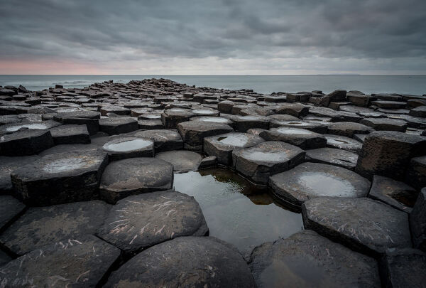 Basalt columns of the Giant's Causeway at sunset, UNESCO World Heritage Site, County Antrim, Northern Ireland, United Kingdom, Europe