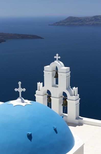 Blue dome and belltower of the church of St. Gerasimos, Firostefani, Fira, Santorini, Cyclades, Greek Islands, Greece, Europe