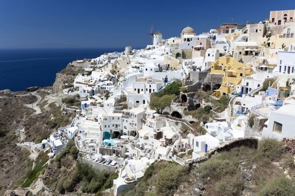 Classic view of the village of Oia with its windmill and whitewashed houses, Oia, Santorini, Cyclades, Greek Islands, Greece, Europe