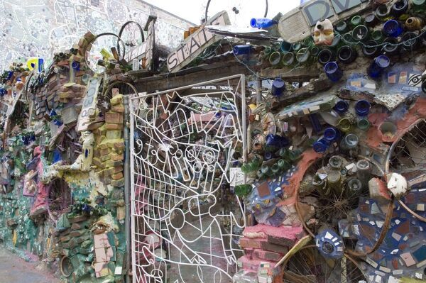 Decoration of patterns in glass, mirrors, ceramics and other fragments of objects embedded in stucco by sculptor Isaiah Zagar, South Street, Philadelphia, Pennsylvania, United States of America