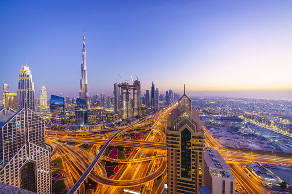 Dubai skyline with Burj Khalifa and Sheikh Zayed Road Interchange, Dubai, United Arab Emirates, Middle East
