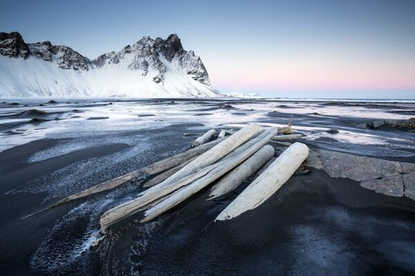 Frozen winter landscape at dusk with Vestrahorn mountains in distance, Stokksnes, South Iceland, Polar Regions