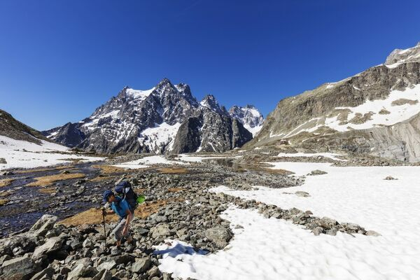 Hiker on a mountain trail, Barre des Ecrins, Ecrins National Park, French Dauphine Alps, Haute Alpes, France, Europe