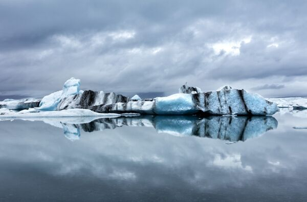 Icebergs and reflections on Jokulsarlon glacial lagoon, South Iceland, Polar Regions