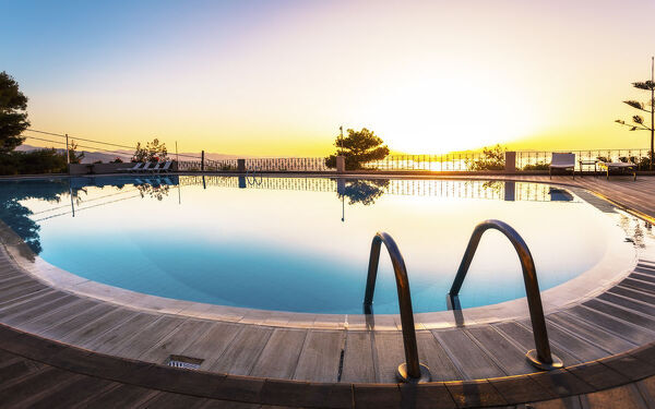 Large swimming pool and sunset over Chania, Crete, Greek Islands, Greece, Europe