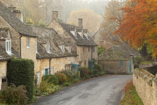 Line of Cotswold stone cottages in autumn mist, Snowshill, Cotswolds, Gloucestershire, England, United Kingdom, Europe