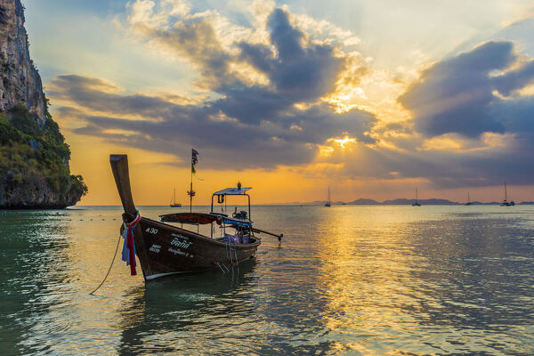 A long tail boat at sunset on Railay beach in Railay, Ao Nang, Krabi Province, Thailand, Southeast Asia, Asia