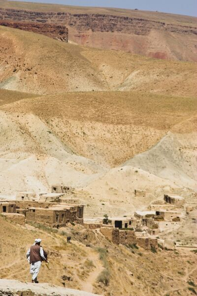 Man walking down mountain road, between Herat and Maimana, after Subzak Pass, Afghanistan, Asia