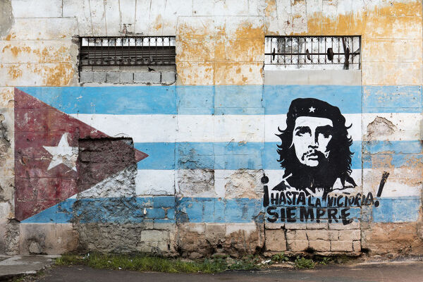 Painting of Che Guevara and Cuban flag on a wall, Havana, Cuba, West Indies, Caribbean, Central America