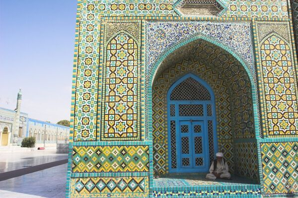 Pilgrim sits in a niche at the Shrine of Hazrat Ali, who was assassinated in 661, Mazar-I-Sharif, Balkh province, Afghanistan, Asia
