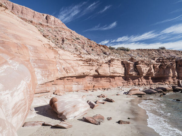 Red sandstone cliffs at Puerto Gato, Baja California Sur, Mexico, North America