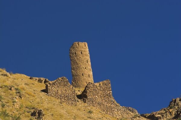 Tower with approximately 82 courses of bricks still standing, Qasr Zarafshan to the north and overlooking the 12th Century Minaret of Jam, Ghor (Ghur, Ghowr) Province, Afghanistan, Asia