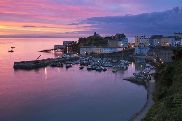 View over harbour and castle at dawn, Tenby, Carmarthen Bay, Pembrokeshire, Wales, United Kingdom, Europe