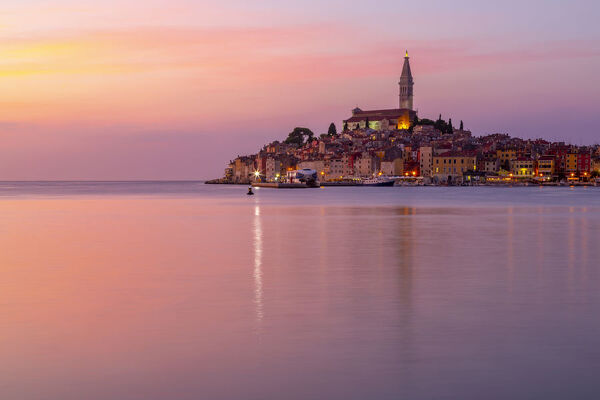 View of harbour and the old town with the Cathedral of St. Euphemia at dusk, Rovinj