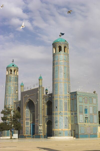 White pigeons fly around the shrine of Hazrat Ali, who was assassinated in 661, Mazar-I-Sharif, Afghanistan, Asia