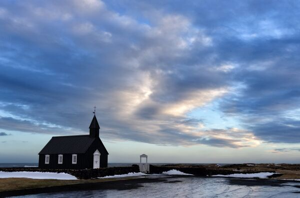 Winter view at dusk of black wooden church at Budir, Snaefellsnes Peninsula, Iceland, Polar Regions