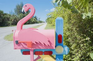 Flamingo made of wood attached to pink mailbox, Sanibel Island, Florida