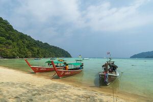 long tailed boats sandy beach thailand southeast
