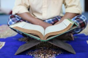 Muslim man reading the Quran in mosque, Ho Chi Minh City, Vietnam, Indochina