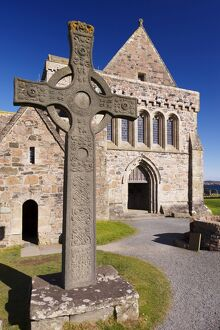 Replica of St. John's cross stands proudly in front of Iona Abbey, Isle of Iona