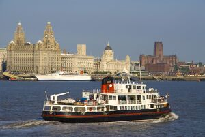 River Mersey ferry and the Three Graces, Liverpool, Merseyside, England