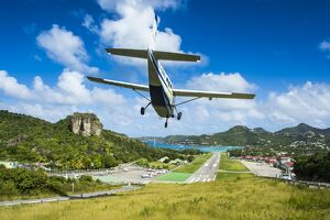 Small airplane landing at the airport of St. Barth (Saint Barthelemy), Lesser Antilles