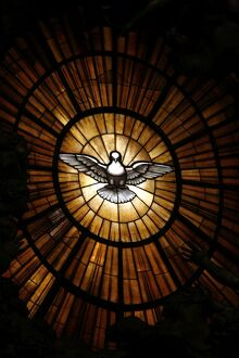 Stained glass window in St. Peter's basilica of Holy Spirit dove symbol